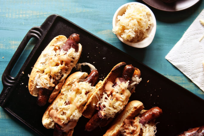 Reuben Hot Dogs on a cast iron griddle. This is how you hot dog!