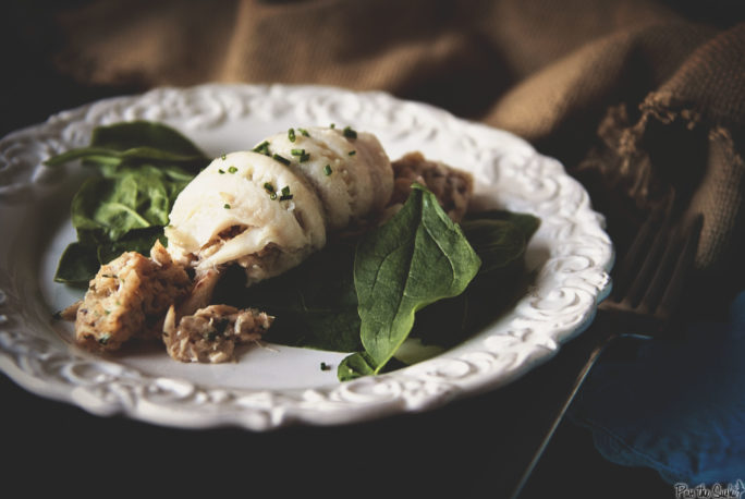 Crab Stuffed Flounder with butter sauce and spinach. Where's your fork?