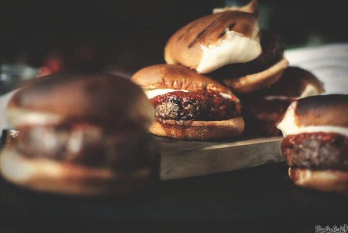 I count 5 Pepperoni Sliders in this photo, with mozzarella and marinara pouring out of them. The question is, where are yours?