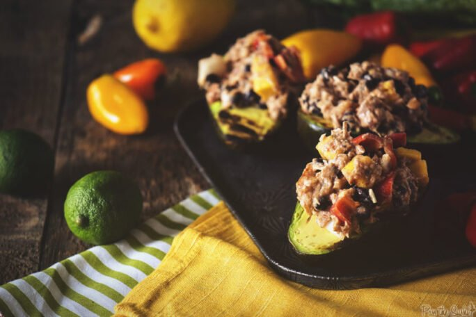 Piles of tuna, peppers and beans are spilling out of these avocado halves. Grab yours. They're going quick!