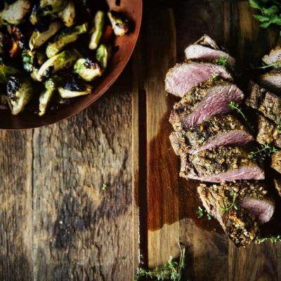 Walnut Crusted Grilled Beef Tenderloins with Charred Brussels