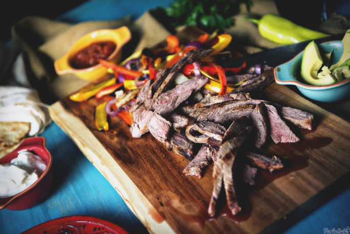 Massive pile of Beer Marinated Steak sliced thin with peppers, onions and avocados!