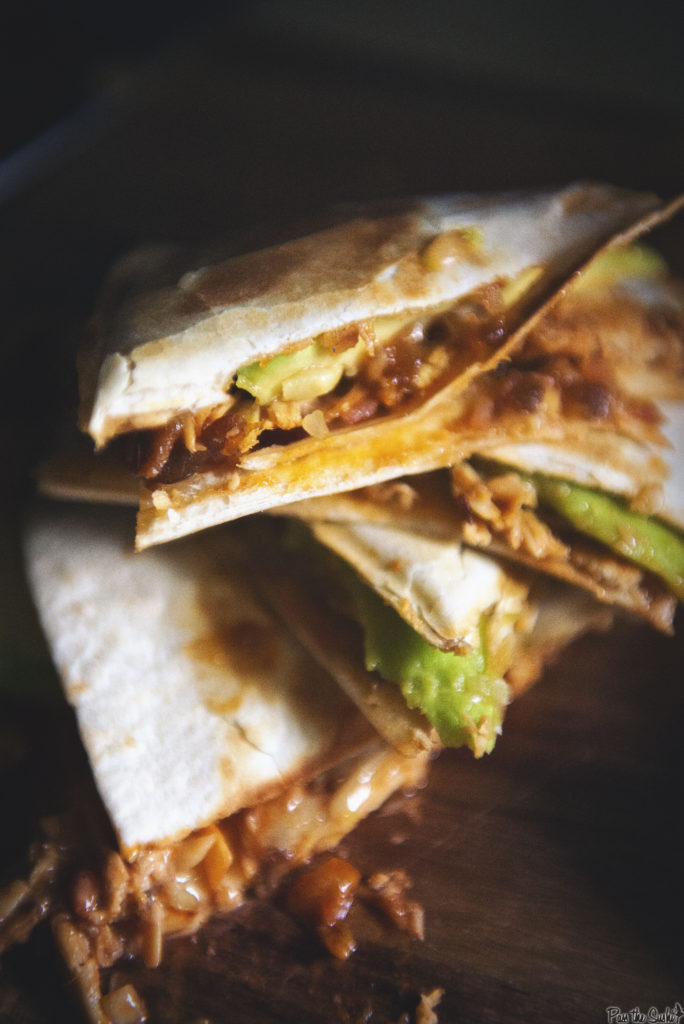 Perfectly grilled tortillas just oozing out layers of cheese, bacon, chicken and avocado. So Good!