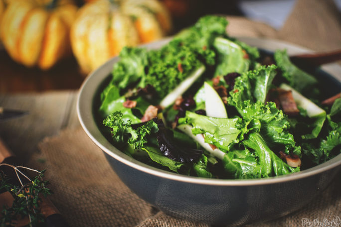 Kale & Apple Salad loaded with bits of Warm Bacon. This is a carnivore's salad.