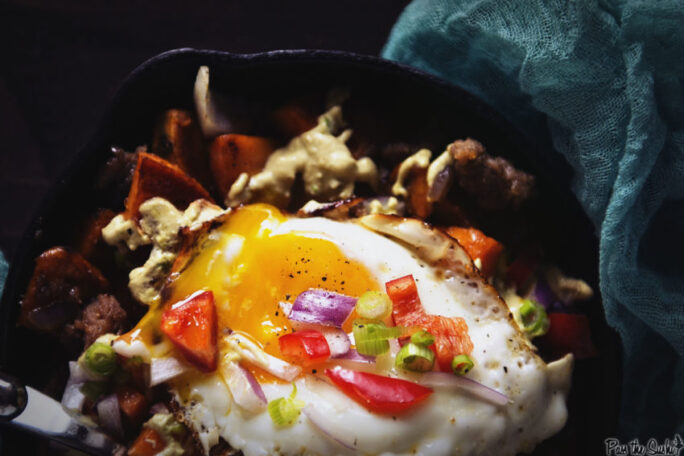 This sunny side up egg is just oozing goodness into a pile of sweet potatoes and sausage. This breakfast hash is legit fuel for your day!