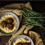 This is my ultimate recipe for delicious rosemary smoked beef and sausage meatballs over a creamy rosemary macaroni and cheese that is to die for! There's something about the smokey flavor and the creamy mac that makes this an amazing combo. You could even make the meatballs as an appetizer but I really love them this way. #meatballs #smokedmeatballs #macandcheese