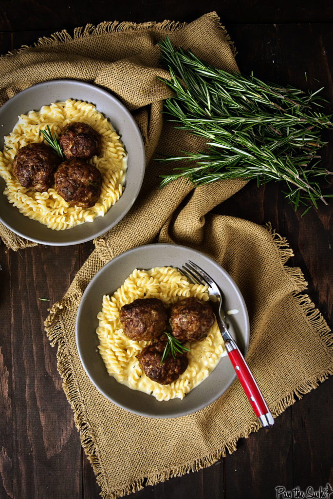 Two bowls of decadently cheesy pasta topped with three meatballs each. This is good eating!