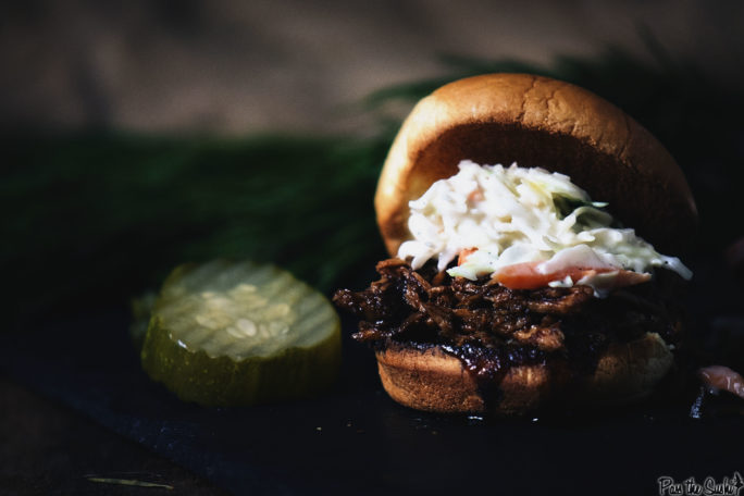 A Pulled Pork Slider just heaped with coleslaw. This is some good eating!