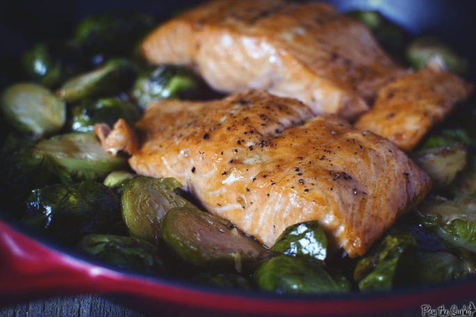 Plump Salmon filets just browed with maple syrup perched atop seared Brussels sprouts. This is what makes dinner magic!