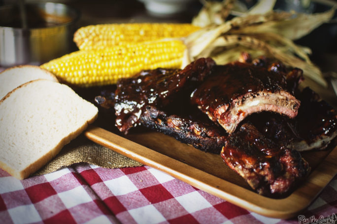 Baby Back Ribs with corn on a wooden tray
