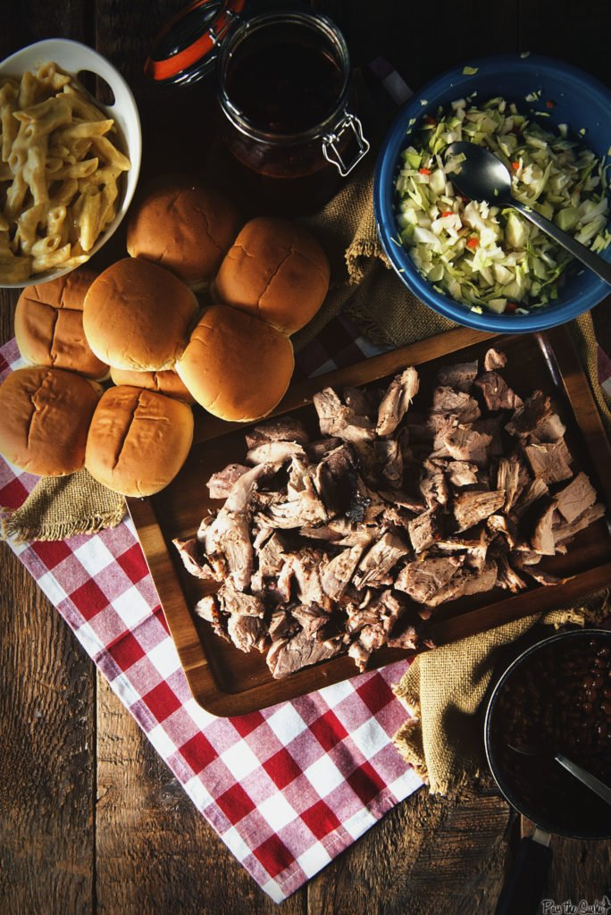 A giant platter of Smoked Pork Shoulder, coleslaw, mac and cheese, baked beans and fresh rolls. This is a feast!