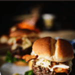 Crazy good beef burgers stuffed with cheddar and topped with a creamy apple slaw