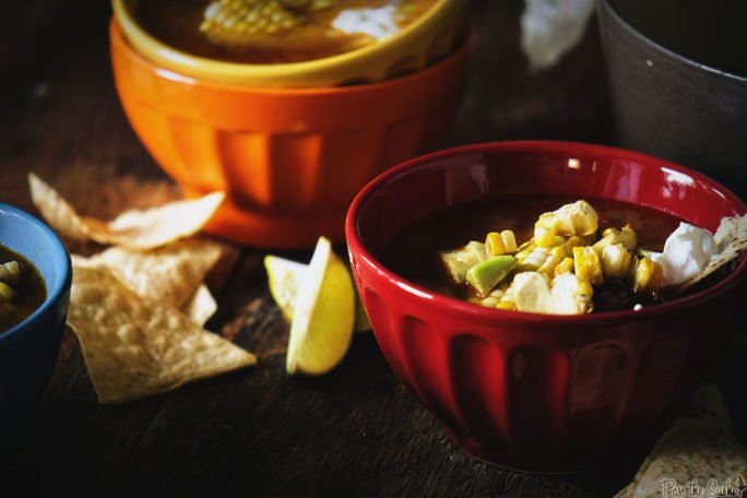 Colorful bowls filled with Grilled Chicken Tequila Tortilla Soup. Extra chips optional.