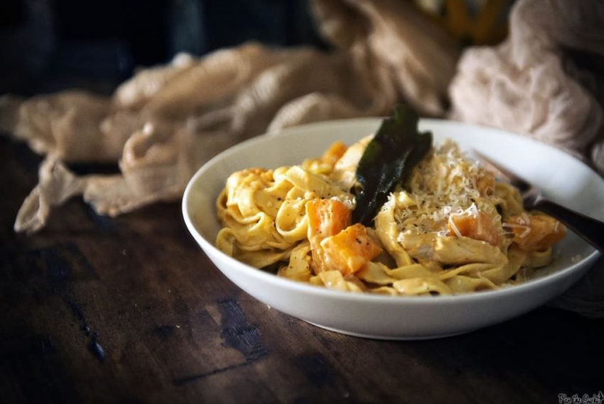 Creamy Pumpkin Alfredo over wide noodles with chunks of Roasted Butternut Squash and Turkey. You have to try this!