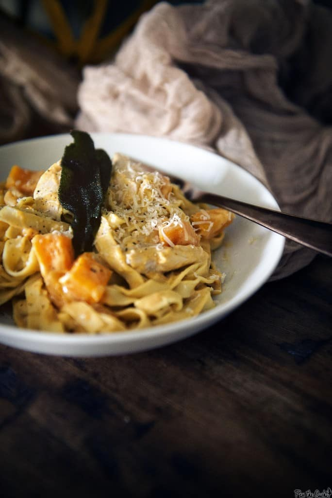 Freshly grated parmesan top this amazing feast. Big chunks of squash and turkey are piled on top of fresh noodles. All tossed in a pumpkin alfredo sauce!