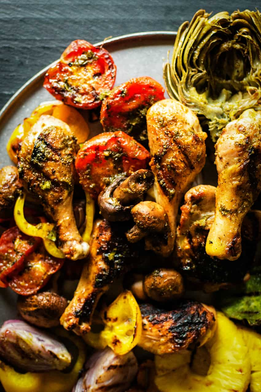 Juicy grilled chicken with vegetables with a fresh chimichurri sauce
