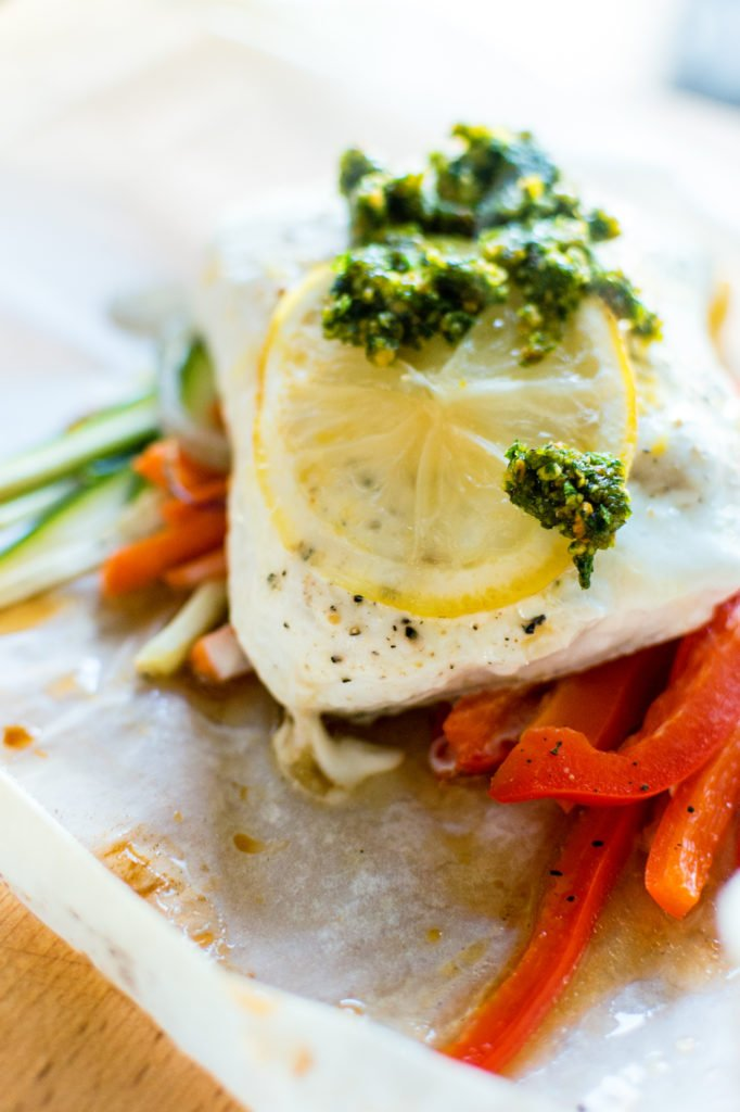 Halibut Baked in Parchment with Pistachio Mint Pesto Recipe | Kita Roberts GirlCarnivore.com