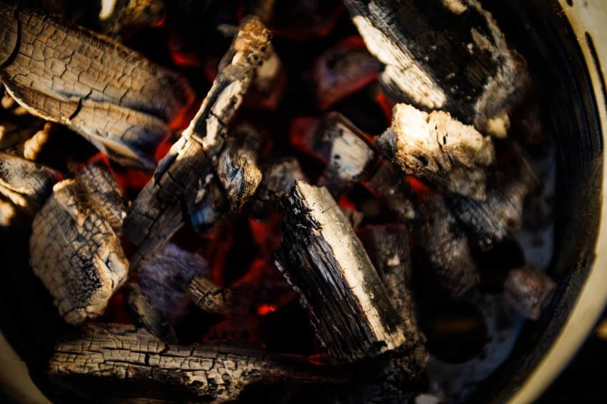 Charcoals lit and burning in Char-Broil Half-Time Chimney Starter