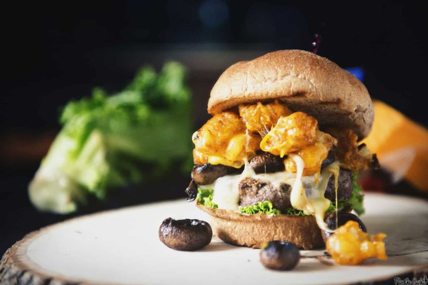 The Spud Muffin Burger - a combo of swiss and colby with mushrooms and tots atop a all beef burger!
