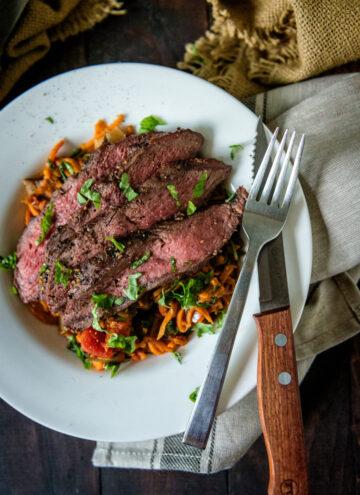 Whole 30 Grilled Flat Iron Steak Over Marinara Tossed Sweet Potato Noodles | Kita Roberts GirlCarnivore.com