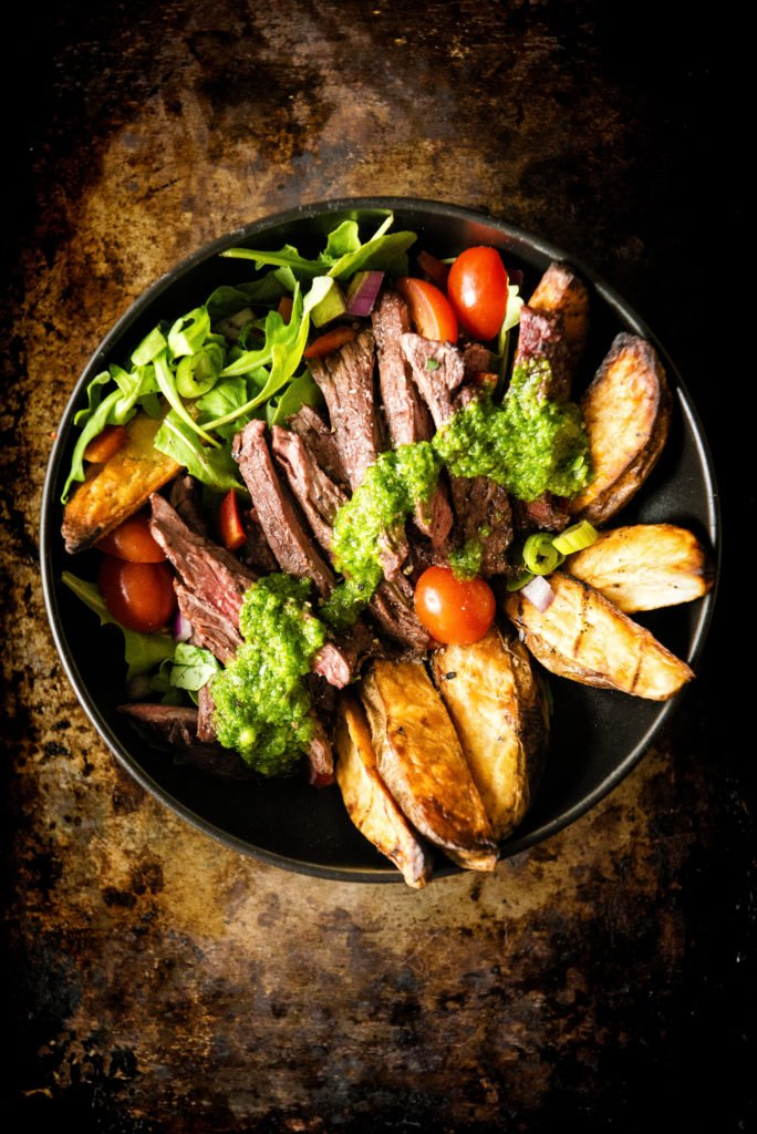 Chimichurri smothering rare Steak, Potatoes, and greens. Yeah, this bowl is packed with power.
