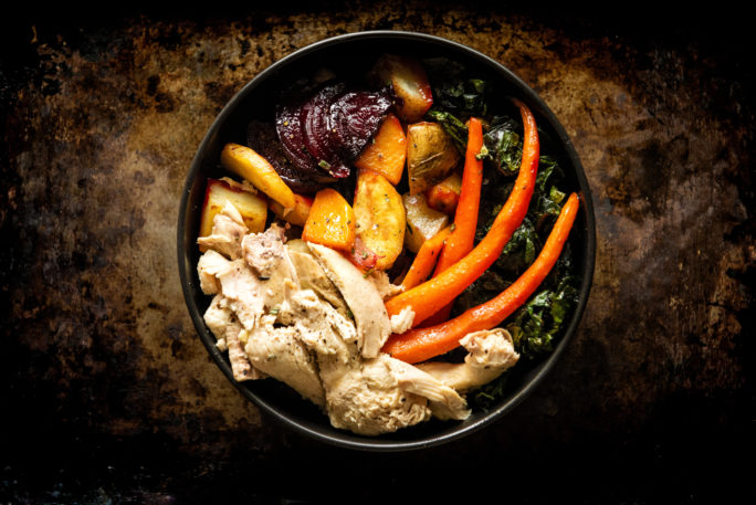 Roasted Roots veggies, chard and chicken make this more than a snack. This power bowl is legit fuel.