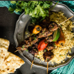 A fast and easy recipe for curry spiced chicken kabobs over coconut and turmeric infused rice