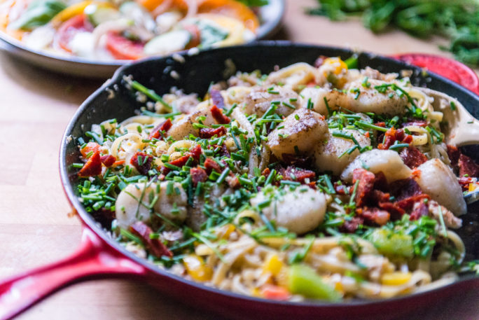 This skillet is filled with an amazing pile of Scallops, Crab, veggies and Pasta. This is fresh. And this is good.