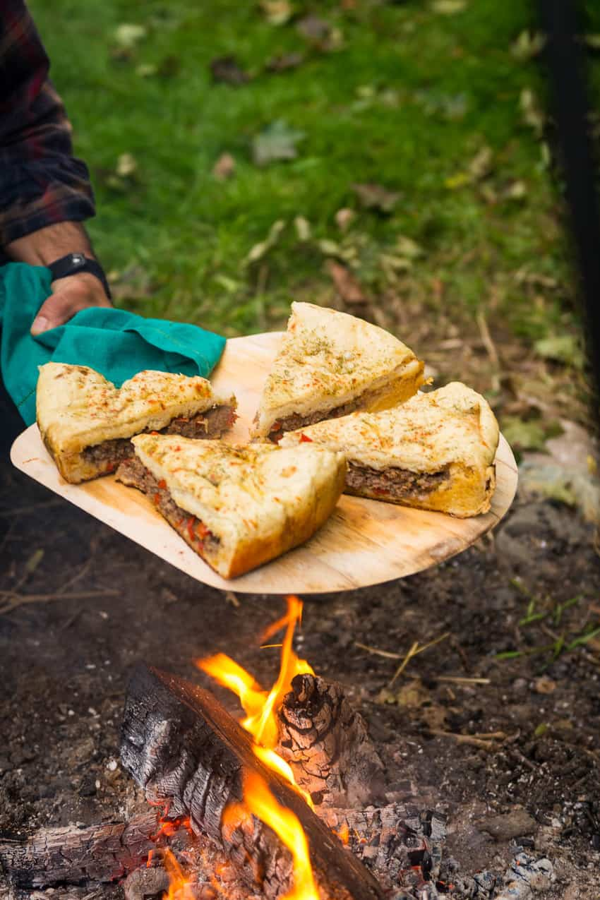 Infuse global flavor into your next pizza with this campfire Berber pizza, Aka, Moroccan Lamb Pizza. A fun stuffed bread baked over a classic campfire.