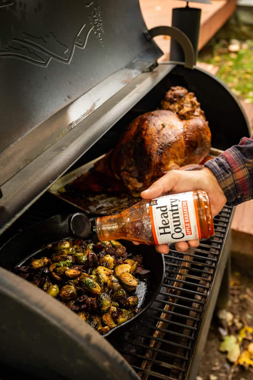 Kita Roberts cooking the BBQ Glazed Smoked Brussels Sprouts with Bacon using Head Country Apple Habanero