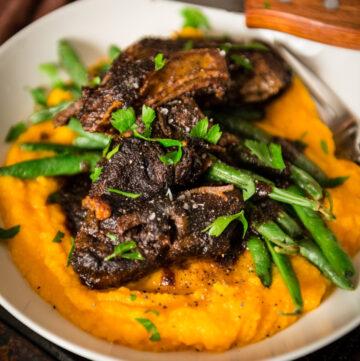 Braised Short Ribs Over Sweet Potato Puree | Kita Roberts GirlCarnivore