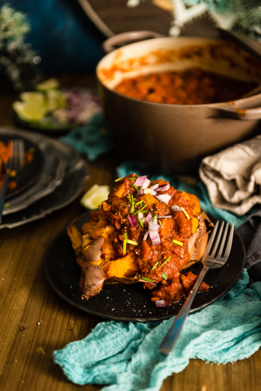 Call me crazy, but this turkey squash chili topping a split sweet potato is about the most filling and healthiest way you can get fat and happy.