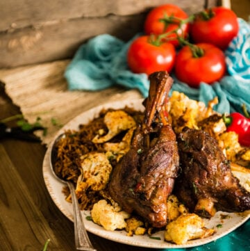 Braised Moroccan lamb shanks with harissa and other African flavors is the perfect fork tender recipe; just like what I enjoyed while traveling through Morocco.
