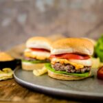 Easy pimento cheese recipe on top of a pork burger.