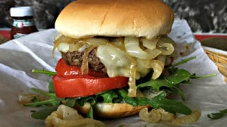 Smoked White Cheddar Burger with Whiskey Glazed Onions