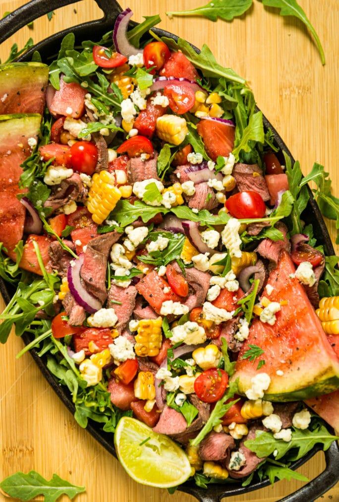 Grilled Flat Iron Steak over Summer Salad Recipe | GirlCarnivore com