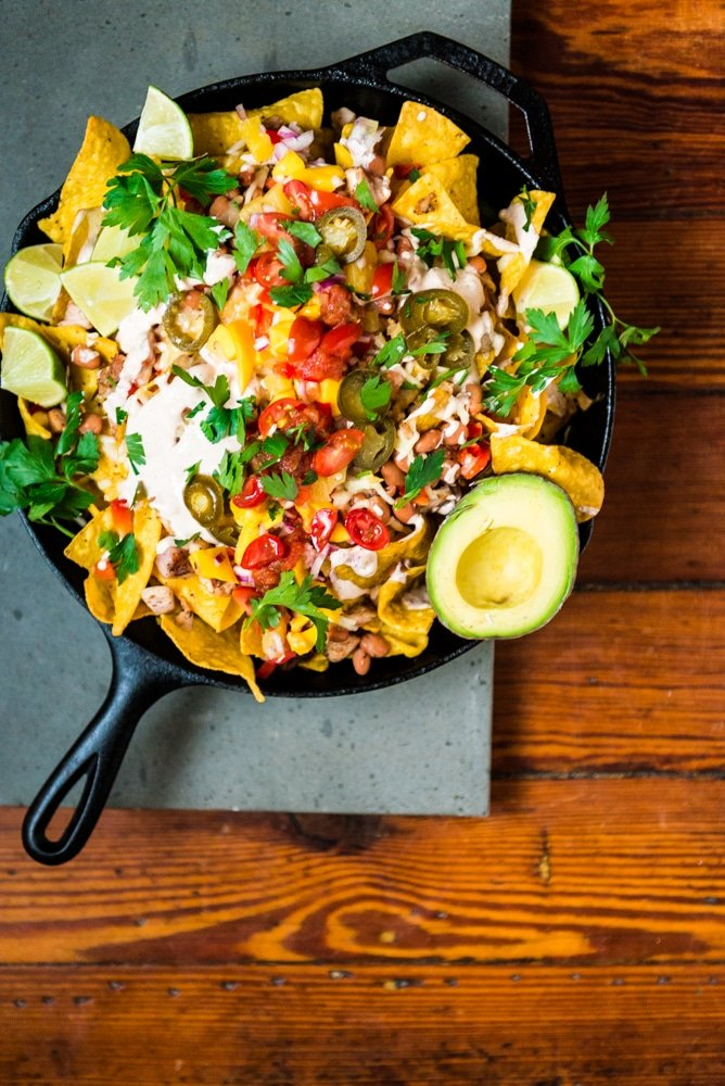 Leftover Chicken Nachos with Mango Salsa and Spicy Crema