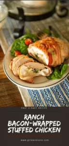 sliced bacon-wrapped chicken that has been stuffed with a creamy spinach mixture over greens on a plate