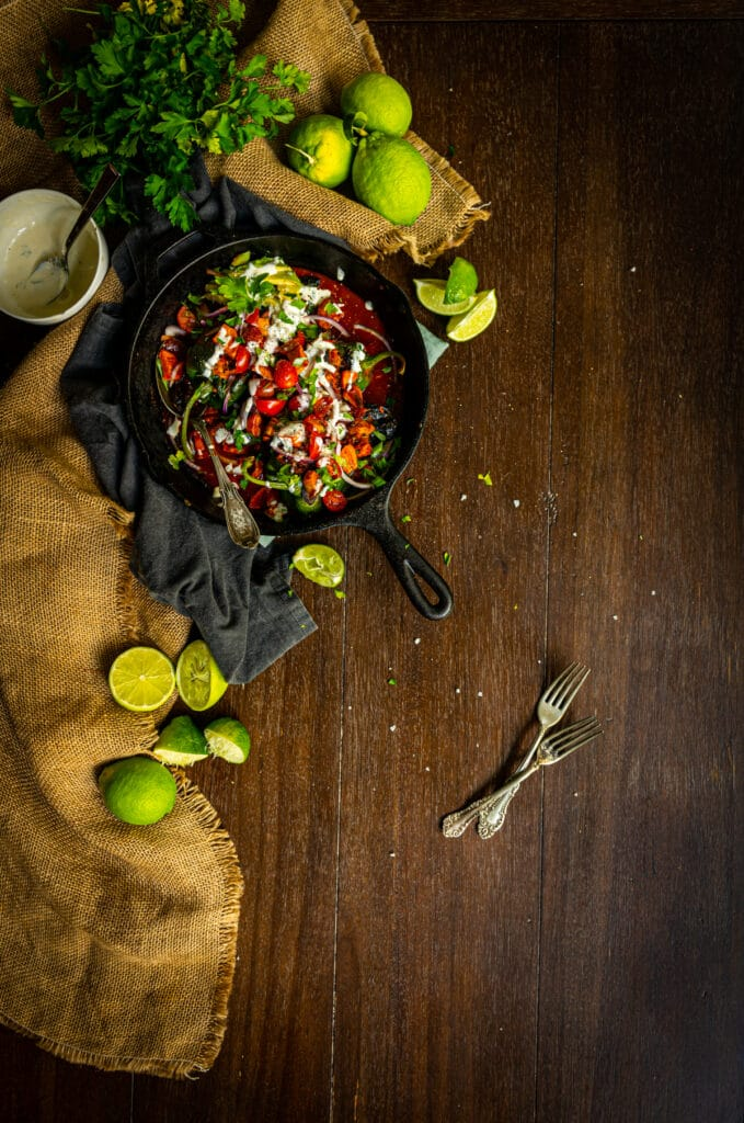poblano peppers stuffed with chicken tinga and topped with cilantro, tomatoes, lime wedges and avocado