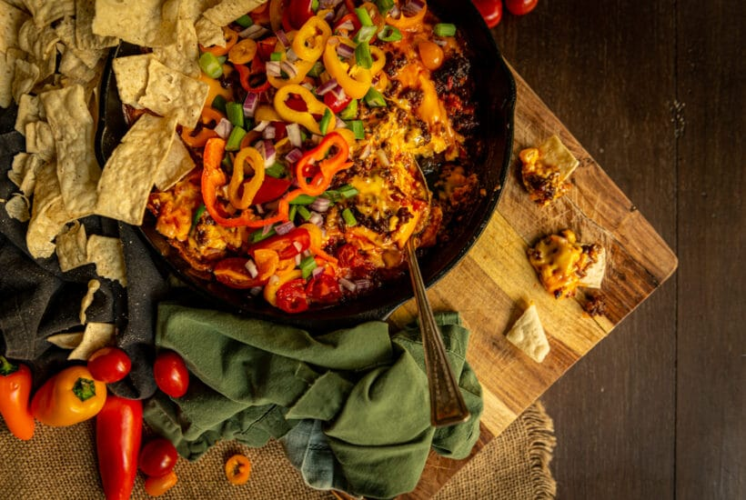 One chip for you, two chips for me! This chorizo dip is my favorite game day snack! In a skillet covered in fresh veggies for that extra pop of crunch!