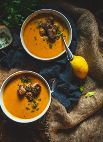 Ginger turkey meatballs in a creamy roasted carrot soup
