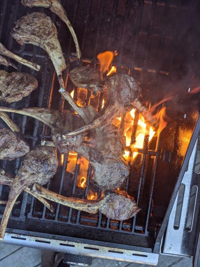 individual lamb chops on a grill