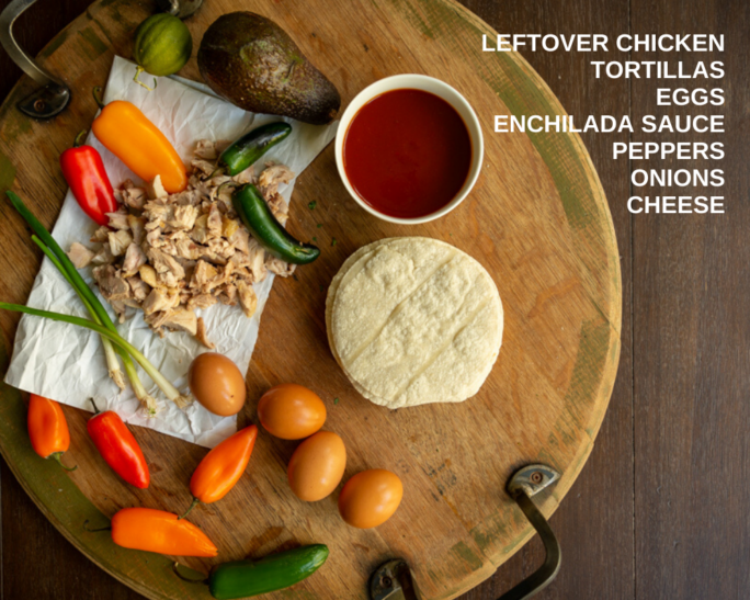 Ingredients for chilaquiles, smoked chicken, tortillas, enchilada sauce peppers and scallions on a board