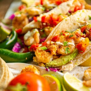 So easy and so delicious grilled shrimp tacos with a Cajun rub, slaw and lime crema