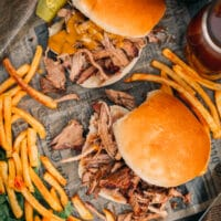Smoked Pulled Pork Sandwiches from the top on a platter with fries