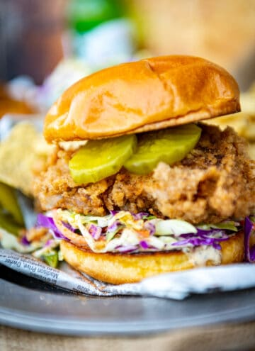 crispy fried chicken sandwich with ranch slaw and pickles waiting to be devoured