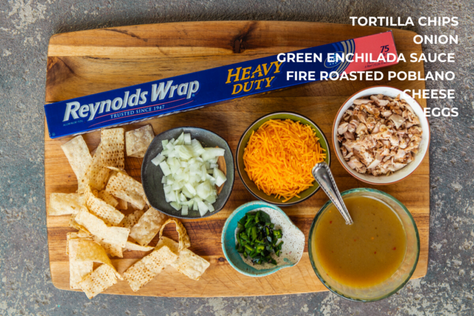 What you need to make chicken chilaquiles with salsa verde, ingredients on a wooden board