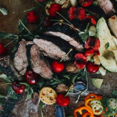 Sliced char-grilled pork tenderloin topped with stone fruit salsa