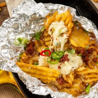 perfect cheese pull on jalapeno popper waffle fries