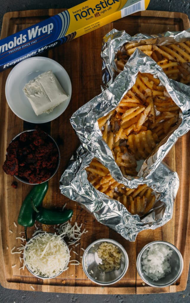close up of waffle fries and ingredients showing waffle fries in foil packets for grilling